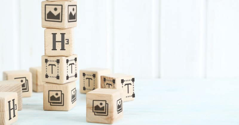 Building blocks stacked on top of each other with Wordpress icons on the faces of the blocks