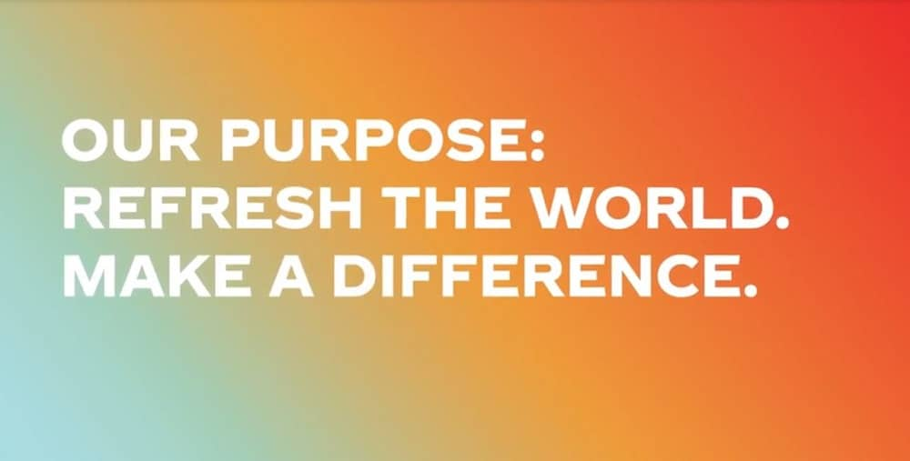 "A multi-color graphic with a rainbow background. Text on graphic states, ""Our purpose: refresh the world. Make a difference."" Coca Cola's brand purpose statement."