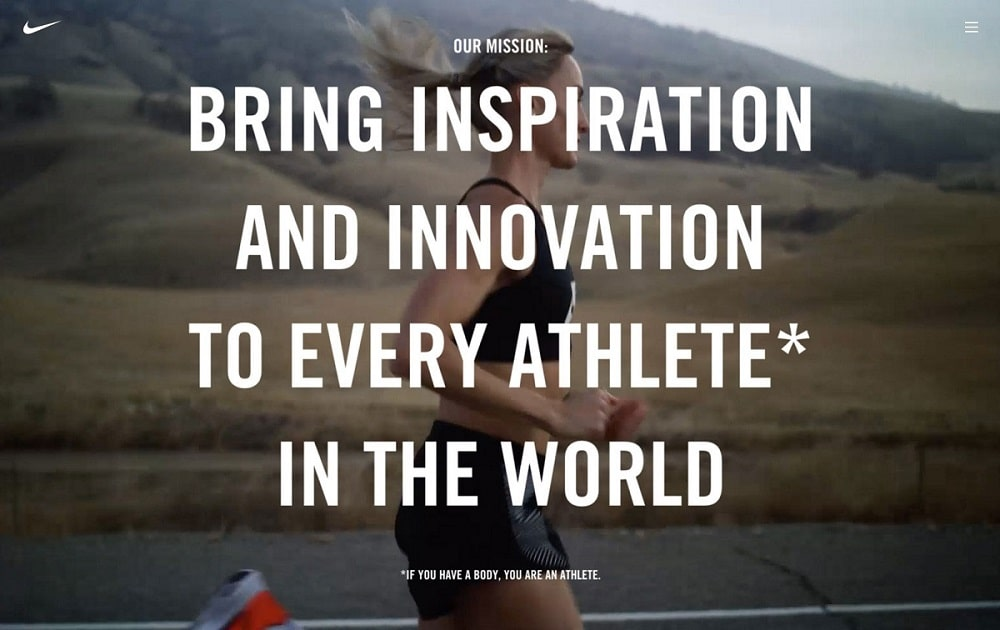 "A woman in workout clothes running on a road with mountain behind her. Text over image states ""Our mission: bring inspiration and innovation to every athlete in the world. If you have a body, you are an athlete."" Nike's brand purpose statement."