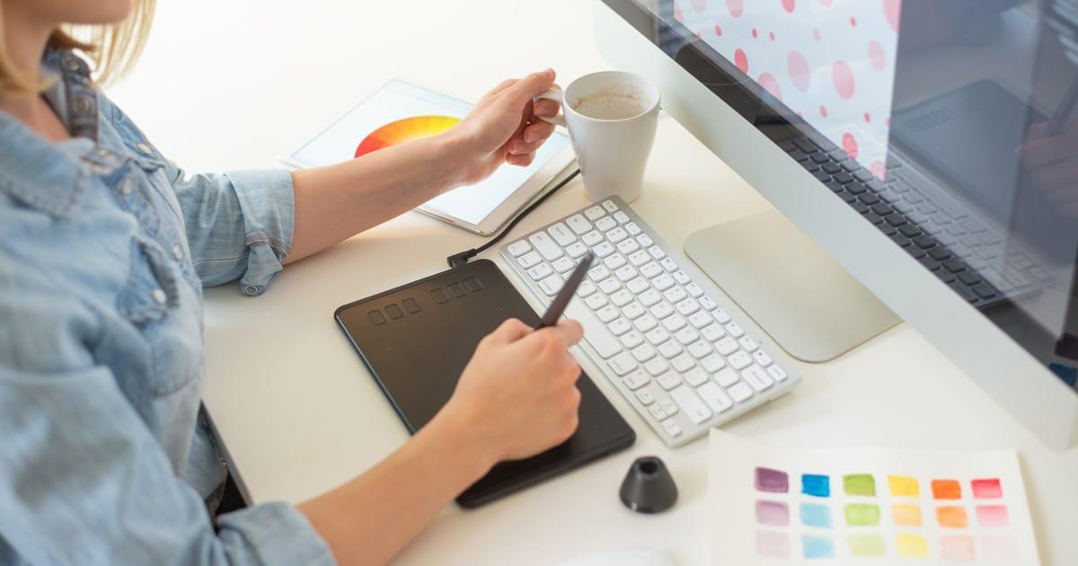 graphic web designer does the work using a graphics tablet, desktop