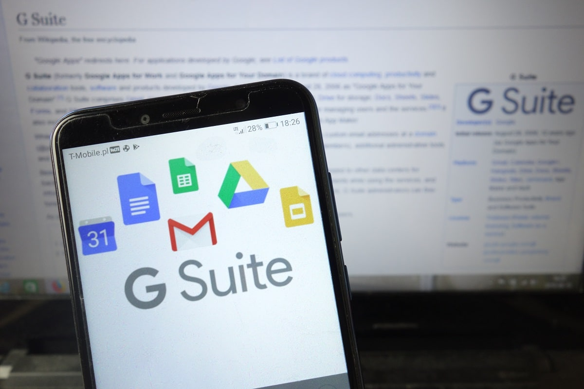 """G Suite logo displayed on mobile phone as person tries to learn, """"What is G Suite?"""""""