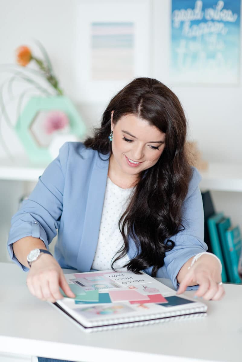 Crystal Dove, owner of Marketing Queen Consulting, looking at stock photos and color swatches
