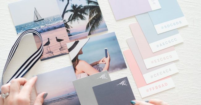 A flatlay of stock photos and color swatches for a brand