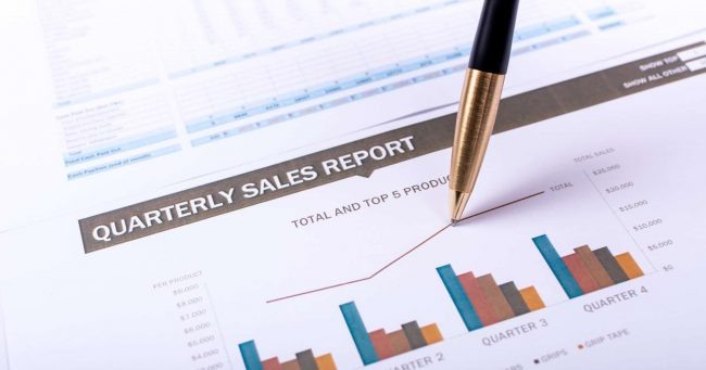 Quarterly sales report colorful bar graph pen drawing increase